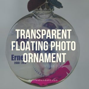 An easy way to display a keepsake on your Christmas tree with a transparent floating photo ornament.
